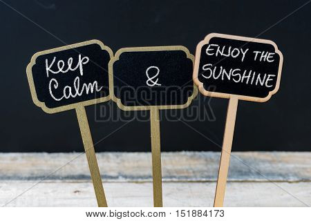 Keep Calm And Enjoy The Sunshine Message Written With Chalk On Mini Blackboard Labels
