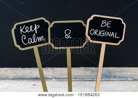 Keep Calm And Be Original Message Written With Chalk On Mini Blackboard Labels