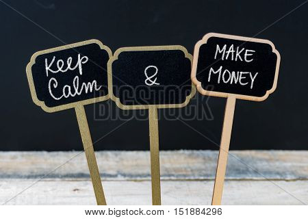 Keep Calm And Make Money Message Written With Chalk On Mini Blackboard Labels