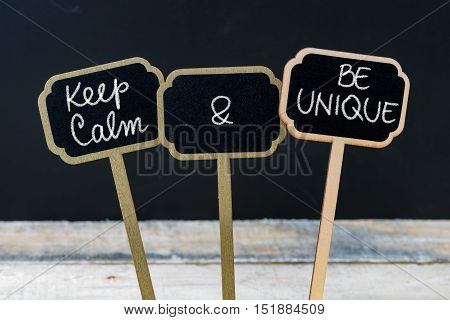 Keep Calm And Be Unique Message Written With Chalk On Mini Blackboard Labels