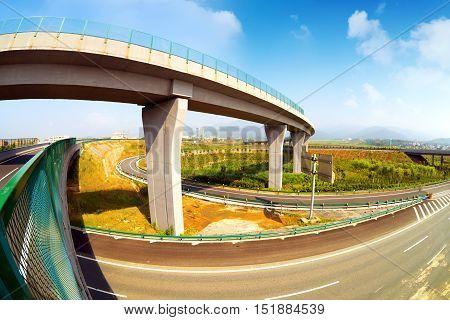 Highway and viaduct under the blue sky