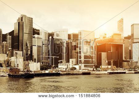 A modern high - rise building in Victoria Harbor, Hong Kong, China