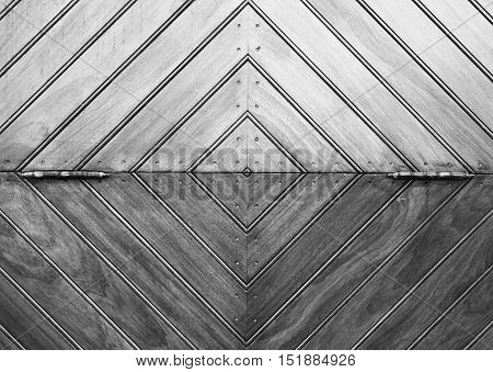 wood hinged diamond designed door monochrome image close