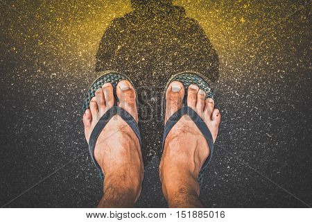 Top View Feet In Sandals Selfie Shot Of Asian Men Legs With Wet Street With Color Effect.