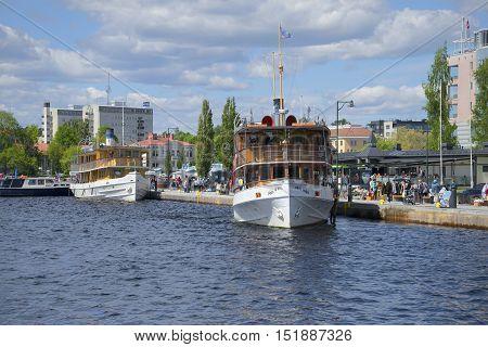 SAVONLINNA, FINLAND - JUNE 06, 2015: Two vintage steamer on lake Saimaa. Tourist landmark of the city Savonlinna, Finland