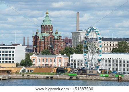 HELSINKI, FINLAND - AUGUST 28, 2016: Uspenskiy Cathedral and the ferris wheel