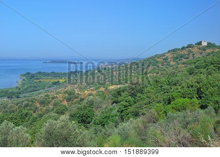View to Lake Trasimeno and Village of Passignano sul Trasimeno,Umbria,Italy