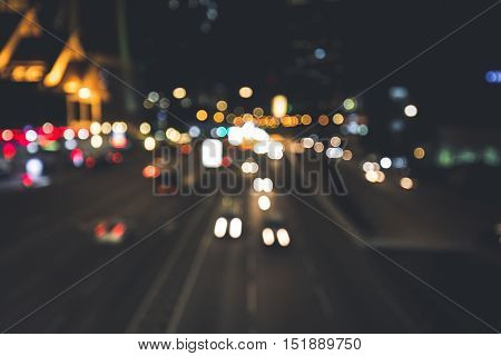 Urban night scene in the city with a lot of lights.