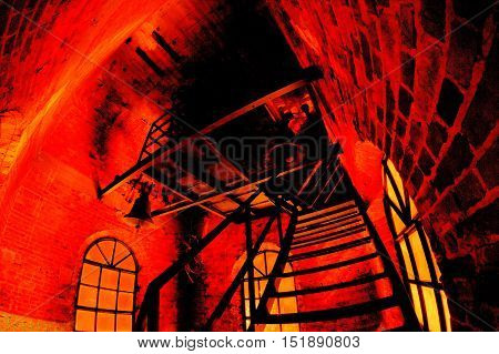 interior of the church tower the stairs leading to the top and bells in heavily distorted perspective