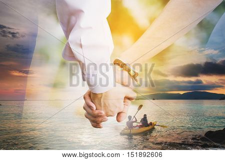 Double exposure couple in love holding hand with kayaking on the ocean in sunset