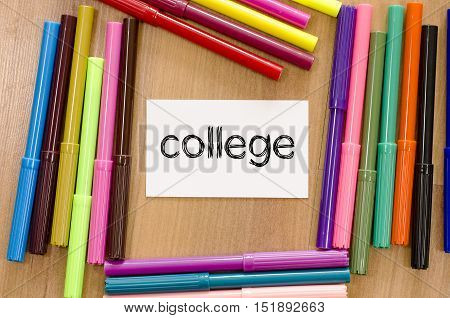Felt-tip pen and note on a wooden background and college text concept