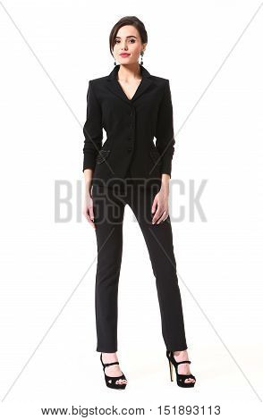 woman with updo hair style in pant power suit high heels shoes full length body portrait standing isolated on white