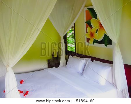 Bali Indonesia - April 13 2014: View of bungalow with bed at Nandini Bali Jungle Resort and Spa.