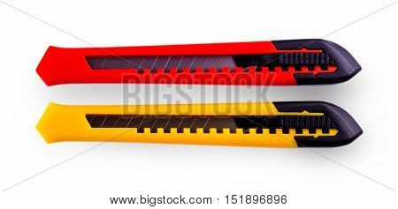 Yellow and red paper cutters with closed blade isolated on white background