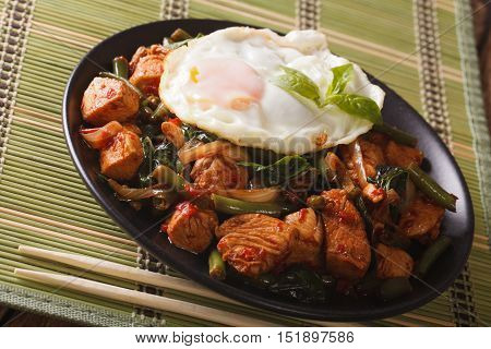 Thai Cuisine: Stir-fry Gai Pad Krapow Chicken On A Plate Close-up Horizontal