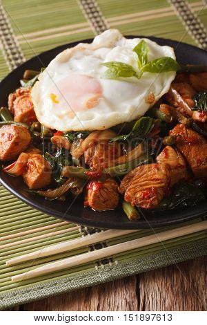 Thai Cuisine: Stir-fry Gai Pad Krapow Chicken On A Plate Close-up Vertical
