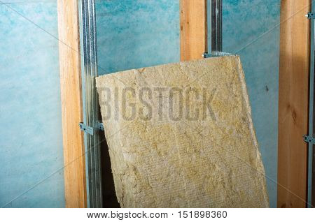 home attic insulation with rock wool on a green background