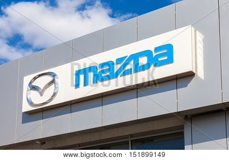 SAMARA RUSSIA - MAY 11 2016: Mazda logo on the facade of official dealer office. Mazda Motor Corporation is a Japanese car brand automotive manufacturer