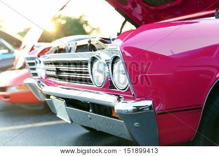 classic retro vintage pink car. Auto show