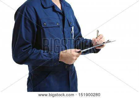 Mechanic in uniform with a clipboard and pen on white background