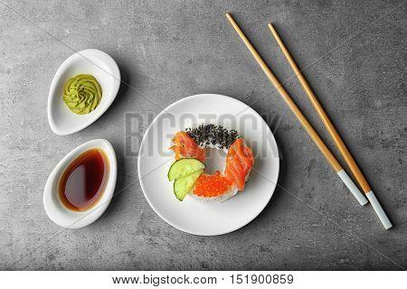 Sushi doughnut on grey textured background