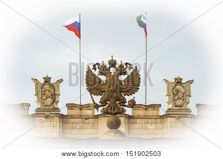 Coat of arms Russian Federation. Coat of arms on background of parapet administrative building government with USSR symbols flags of Russia and Belgorod region. Focus on the two-headed eagle. Photo with vignetting effect.