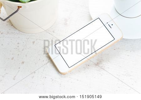 Mock up styled flat lay white hight key scene with white phone, copy space on blank screen