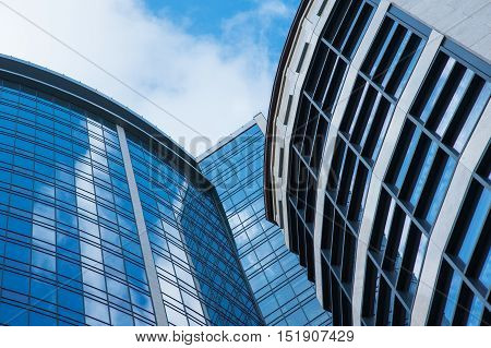 modern architecture buildings exterior background. clouds sky reflection in skyscrapers.