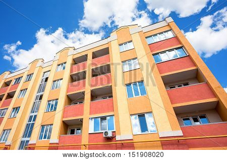 New modern apartment building against the blue sky background