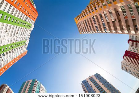 New tall apartment buildings against blue sky background