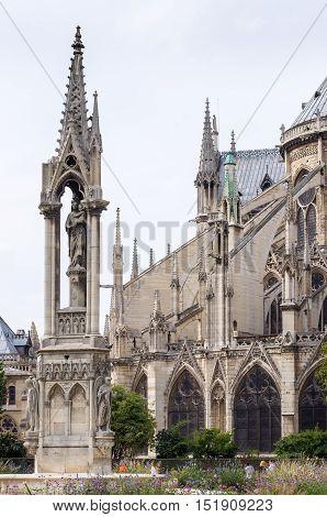 Fontaine De La Vierge And Cathedral Notre-dame De Paris.