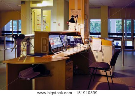 Empty workplace of reception in office building at summer evening