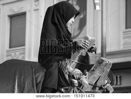 Istanbul Turkey - October 11 2016: Muslims worldwide marks Ashura Istanbul Shiite community. Parents carried on by a camel girl seen. Caferis take part in a mourning procession marking the day of Ashura in Istanbul's Kucukcekmece district Turkey