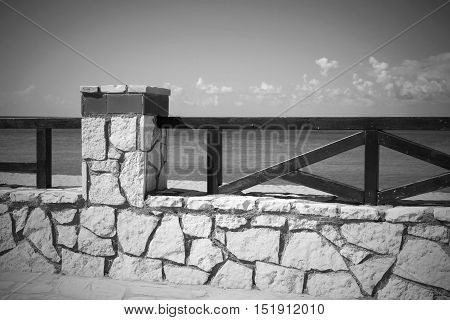architecture of the stone embankment or seafront with a fence closeup of monochrome tone in retro style
