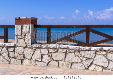 architecture of the stone embankment or seafront with a fence closeup