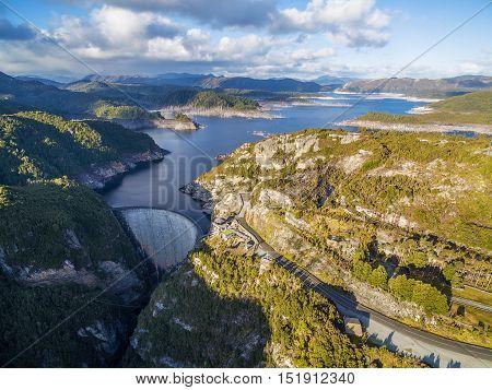 Aerial View Of Gordon Dam And Lake At Sunset. Southwest, Tasmania