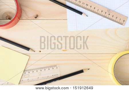 Workplace. School or office stationery on wooden board with copyspace