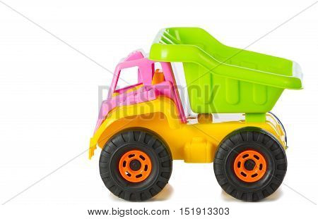 Plastic toy truck with white in background