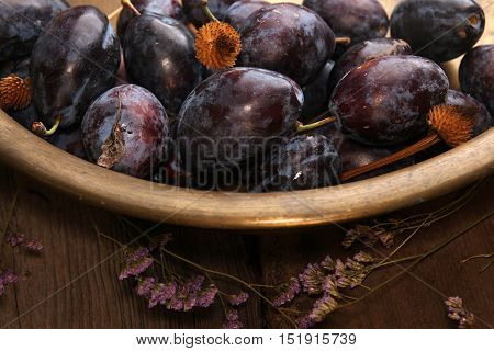 Natural Organic Plums In Copper Basin. Rustic Style.