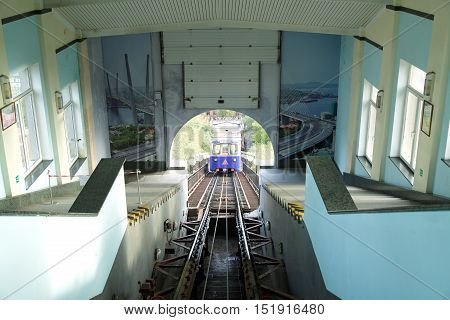 Vladivostok Russia - October 08th 2016: Vladivostok cable car with the going one car buildings are photographed from within.