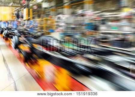 actory floor car production line motion blur picture.
