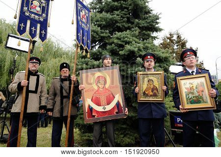 Orel Russia - October 14 2016: Ivan the Terrible monument opening ceremony. People in cossack uniforms with orthodox icons and banners closeup