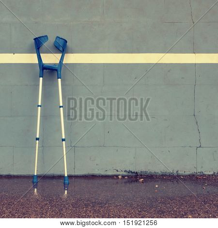 Two Used Medical Crutch At Training Tennis Wall  On Court,