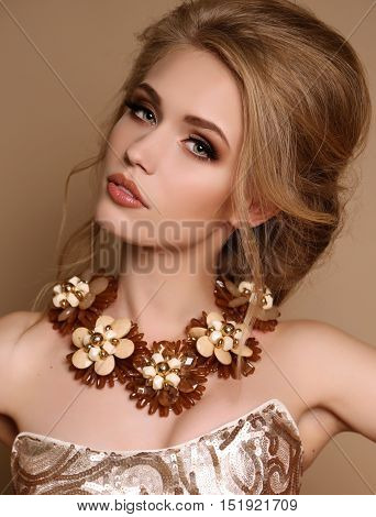 Woman With Blond Hair And Bright Makeup With Luxurious Necklace