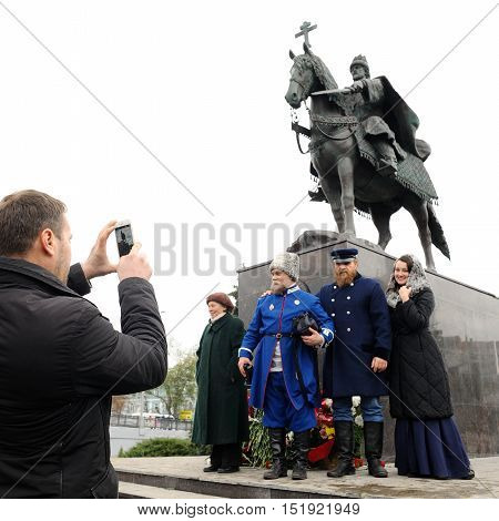 Orel Russia - October 14 2016: Ivan the Terrible monument opening ceremony. People in cossack uniforms posing for photo with Ivan the Terrible monument beside