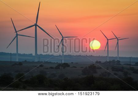 Wind turbines at sunset - Renewable energy concept