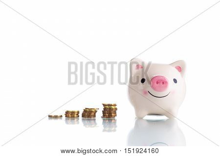 White piggy bank with increasing stack gold coin money isolated on white background - investment, saving and plan concept