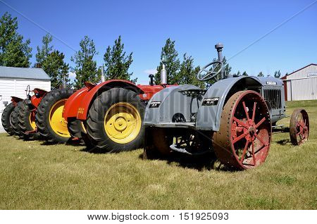 WATFORD CITY, NORTH DAKOTA, June 23, 2016: Vintage McCormick Deering, Massey Harris, and other tractors are displayed at the Watford City Pioneer Museum which is open and free to the public.