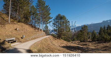 hillside walkway kramerplateau near garmisch with wooden bench and mountain view bavaria.