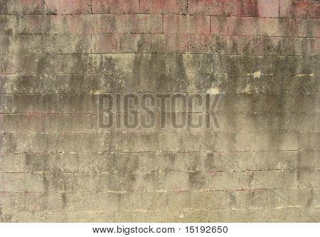 Large Stone Wall With Some Pink Discoloration